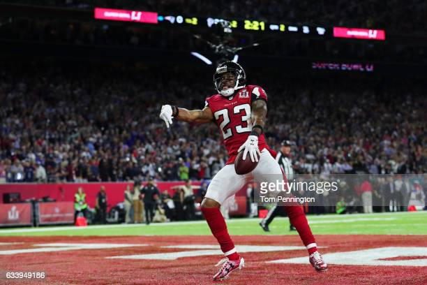 Robert Alford of the Atlanta Falcons celebrates after scoring a touchdown on a 82 yard interception against the New England Patriots in the second...
