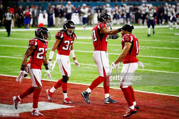 Robert Alford of the Atlanta Falcons reacts after scoring a touchdown on a 82 yard interception against the New England Patriots in the second...