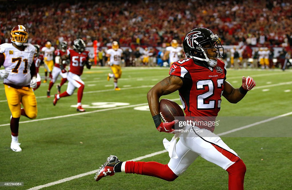 Robert Alford of the Atlanta Falcons returns an interception for a touchdown in their 2519 overtime win against the Washington Redskins at Georgia...
