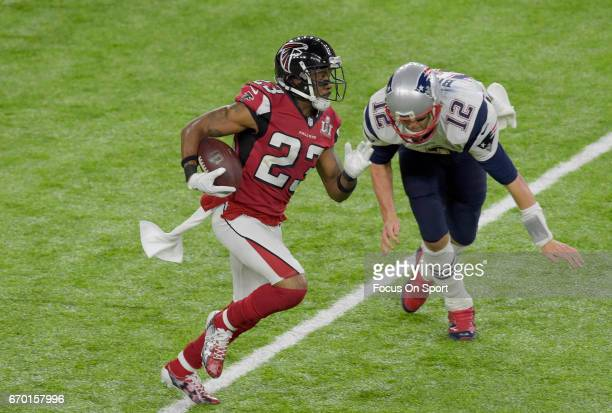 Robert Alford of the Atlanta Falcons returns an interception for a touchdown against the New England Patriots during Super Bowl 51 at NRG Stadium on...