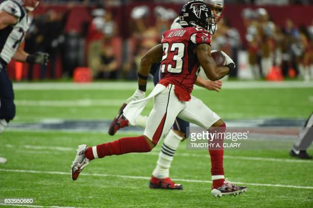Robert Alford of the Atlanta Falcons runs past a player of the New England Patriots to score a touchdown on a 82 yard interception against the New...
