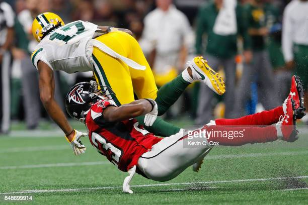 Robert Alford of the Atlanta Falcons tackles Davante Adams of the Green Bay Packers during the second half at MercedesBenz Stadium on September 17...