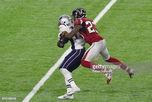 Robert Alford of the Atlanta Falcons tackles Malcolm Mitchell of the New England Patriots during Super Bowl 51 at NRG Stadium on February 5 2017 in...