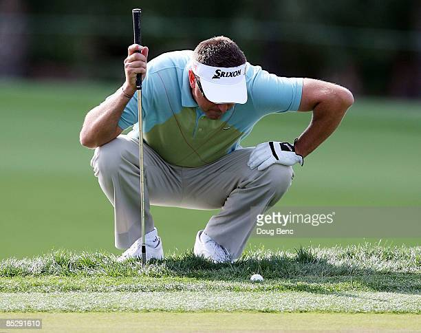Robert Allenby gets a close look at the lie of his ball on the ninth hole during the third round of The Honda Classic at PGA National Resort and Spa...