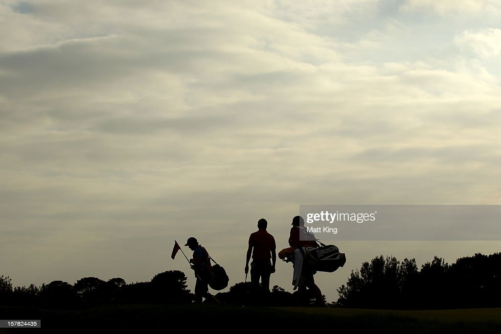 <a gi-track='captionPersonalityLinkClicked' href=/galleries/search?phrase=Robert+Allenby&family=editorial&specificpeople=178193 ng-click='$event.stopPropagation()'>Robert Allenby</a> of Australia and his caddie walk onto the green during round two of the 2012 Australian Open at The Lakes Golf Club on December 7, 2012 in Sydney, Australia.
