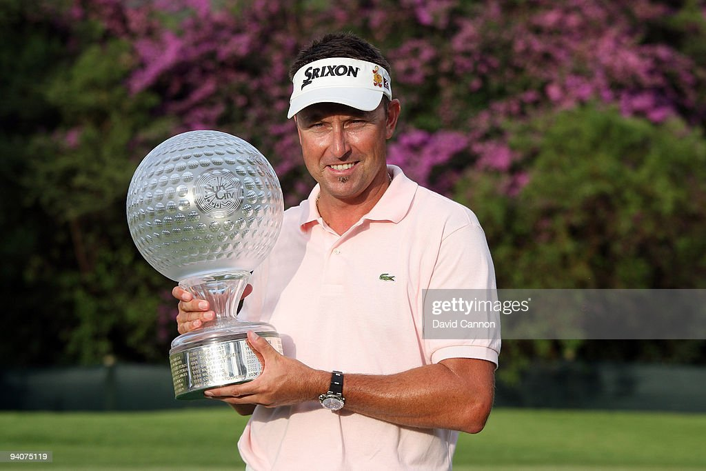 Robert Allenby of Australia holds the trophy after the final round of the Nedbank Golf Challenge at the Gary Player Country Club at Sun City on...