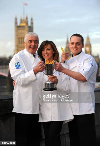 Robert and Alison Smith and their son Jeff celebrate by the Thames after winning the 2008 national Fish Chip Shop of the Year competition at a...