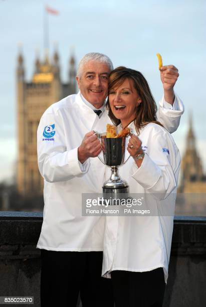 Robert and Alison Smith celebrate by the Thames after winning the 2008 national Fish Chip Shop of the Year competition at a ceremony in London