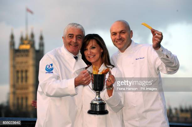Robert and Alison Smith celebrate by the Thames with chef Simon Rimmer after winning the 2008 national Fish Chip Shop of the Year competition at a...