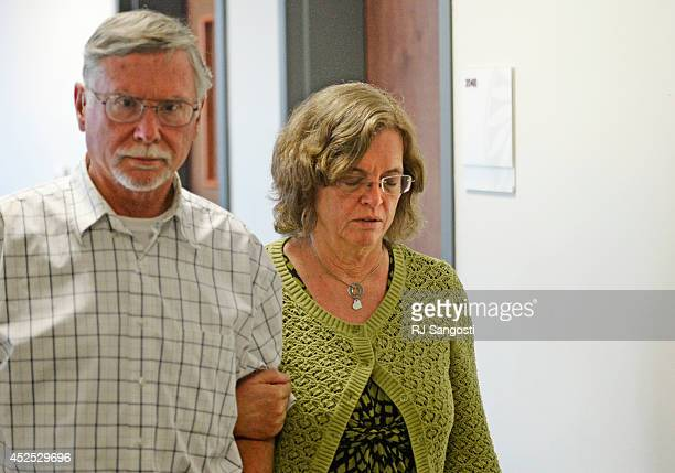Robert and Arlene Holmes parents of Aurora theater shooting suspect James Holmes walk from the courtroom at the Arapahoe County Justice Center for a...