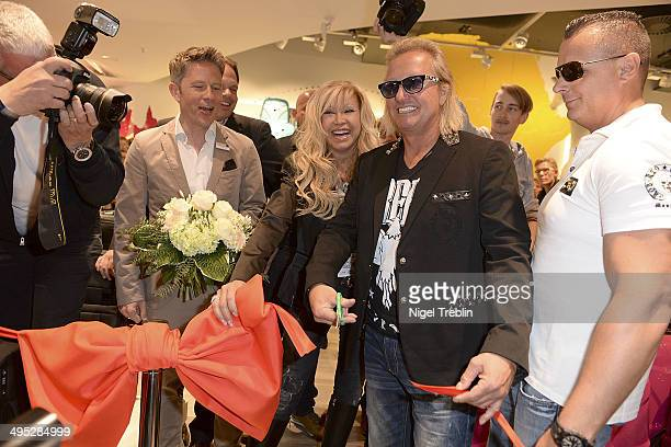 Robert And Carmen Geiss pose during the opening event of a new Titan Shop on June 2 2014 in Osnabruck Germany