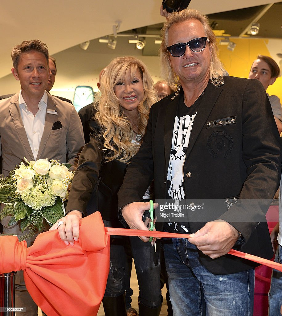 Robert And Carmen Geiss pose during the opening event of a new Titan Shop on June 2, 2014 in Osnabruck, Germany.