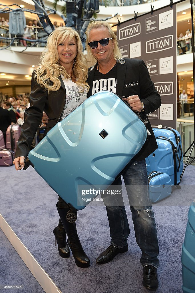 Robert And <a gi-track='captionPersonalityLinkClicked' href=/galleries/search?phrase=Carmen+Geiss&family=editorial&specificpeople=6704196 ng-click='$event.stopPropagation()'>Carmen Geiss</a> pose with a Titan suitcase during the opening event of a new Titan Shop on June 2, 2014 in Osnabruck, Germany.