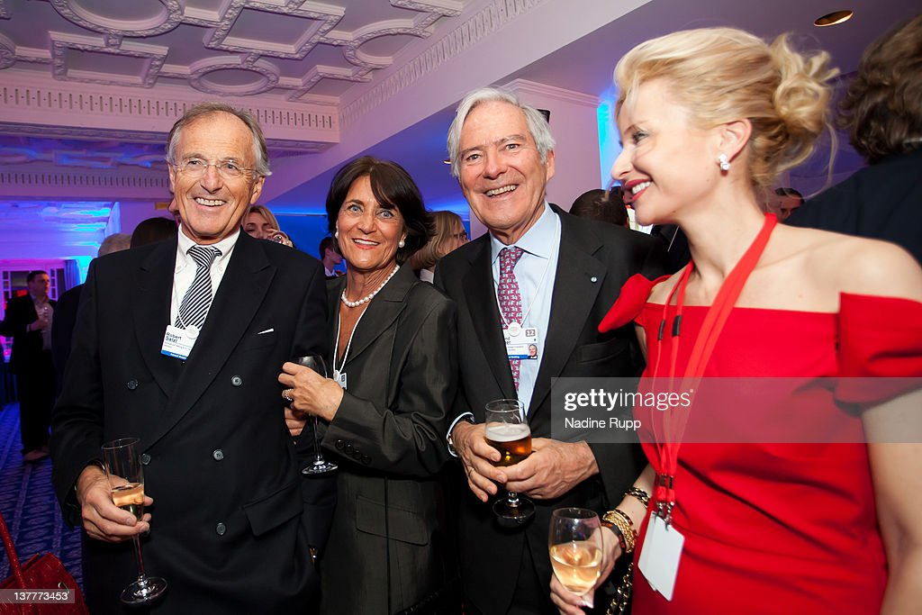 Robert and Helga Salzl, Prof. Roland Berger, founder and Chairman of Roland Berger Strategy Consultants and Sandra Navidi, CEO BeyondGlobal attend the Burda DLD Nightcap 2011 at the Steigenberger Belvedere hotel on January 25, 2012 in Davos, Switzerland.