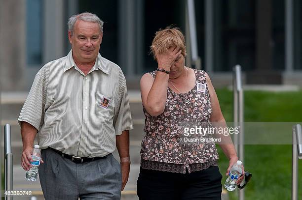 Robert and Sue Sullivan the grandparents of the Aurora Colorado theater shooting victim Veronica MoserSullivan walk out of the Arapahoe County...