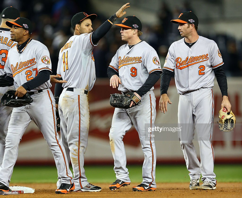 <a gi-track='captionPersonalityLinkClicked' href=/galleries/search?phrase=Robert+Andino&family=editorial&specificpeople=628104 ng-click='$event.stopPropagation()'>Robert Andino</a> #11 of the Baltimore Orioles congratulates <a gi-track='captionPersonalityLinkClicked' href=/galleries/search?phrase=Nate+McLouth&family=editorial&specificpeople=536572 ng-click='$event.stopPropagation()'>Nate McLouth</a> #9 after defeating the New York Yankees in thirteen innins in Game Four of the American League Division Series at Yankee Stadium on October 11, 2012 in the Bronx borough of New York City.