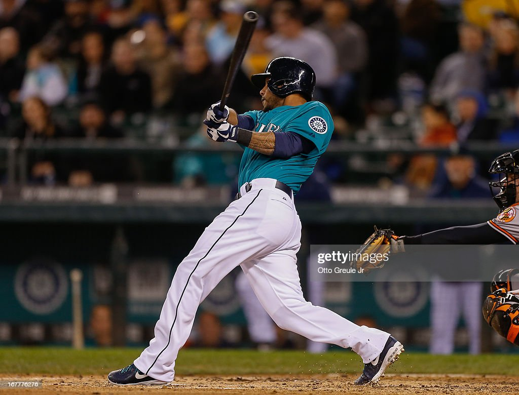 <a gi-track='captionPersonalityLinkClicked' href=/galleries/search?phrase=Robert+Andino&family=editorial&specificpeople=628104 ng-click='$event.stopPropagation()'>Robert Andino</a> #3 of the Seattle Mariners hits an RBI single in the fourth inning against the Baltimore Orioles at Safeco Field on April 29, 2013 in Seattle, Washington.