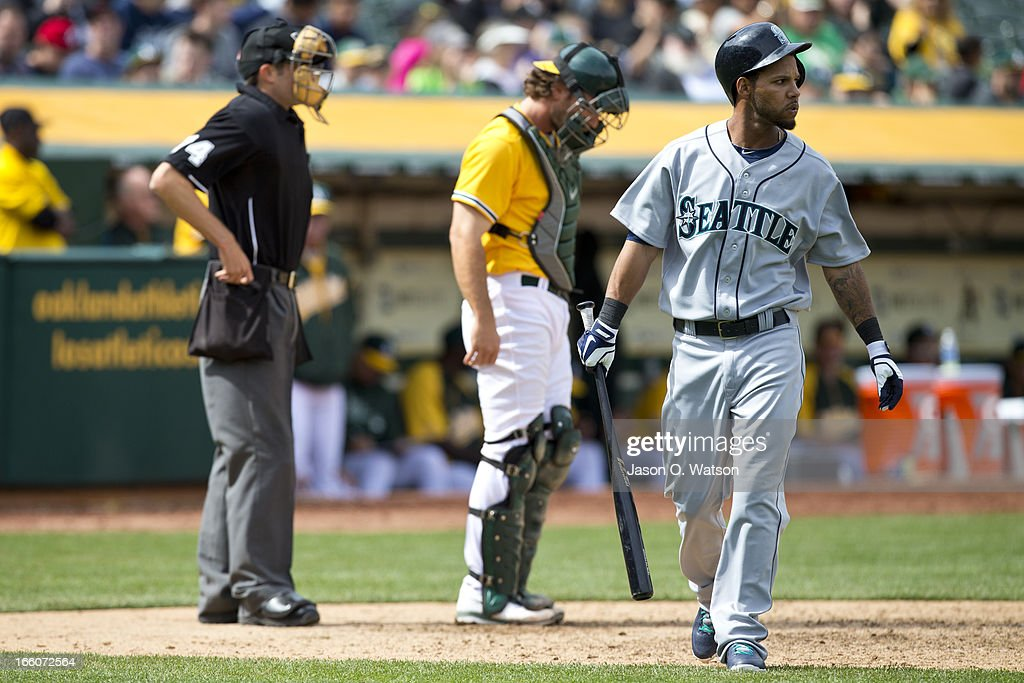 <a gi-track='captionPersonalityLinkClicked' href=/galleries/search?phrase=Robert+Andino&family=editorial&specificpeople=628104 ng-click='$event.stopPropagation()'>Robert Andino</a> #3 of the Seattle Mariners returns to the dugout after striking out against the Oakland Athletics during the ninth inning at O.co Coliseum on April 4, 2013 in Oakland, California. The Oakland Athletics defeated the Seattle Mariners 8-2.