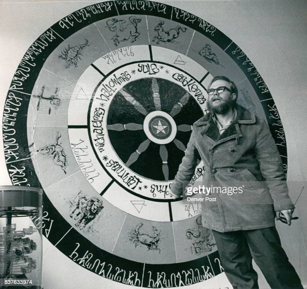 Robert Artison Explains Witches Wheel Painted on Wall on Denver Shop Letters on outside are of ancient witches language Rune Next are 12 signs of...