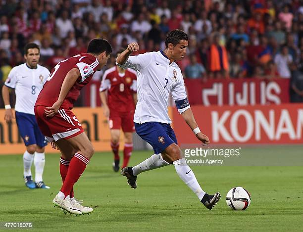 Robert Arzumanyan of Armenia vies with Cristiano Ronaldo of Portugal during the UEFA Euro 2016 qualifying match between Armenia and Portugal at...
