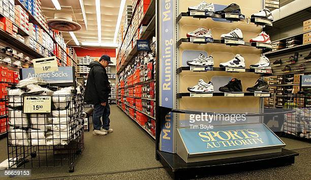 Robert Asakura shops for athletic shoes at a Sports Authority store January 24 2006 in Niles Illinois Sports Authority has announced that it has...