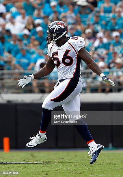 Robert Ayers of the Denver Broncos celebrates a sack during the NFL season opener game against the Jacksonville Jaguars at EverBank Field on...