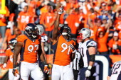 Robert Ayers of the Denver Broncos celebrates a stop in the second quatrer against the New England Patriots during the AFC Championship game at...