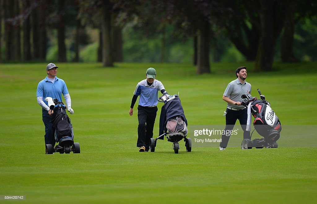 Robert Bardsley of Moor Hall Golf Club (right) walks down the 18th fairway during the PGA Assistants Championships - Midlands Qualifier at the Coventry Golf Club on May 26, 2016 in Coventry, England.