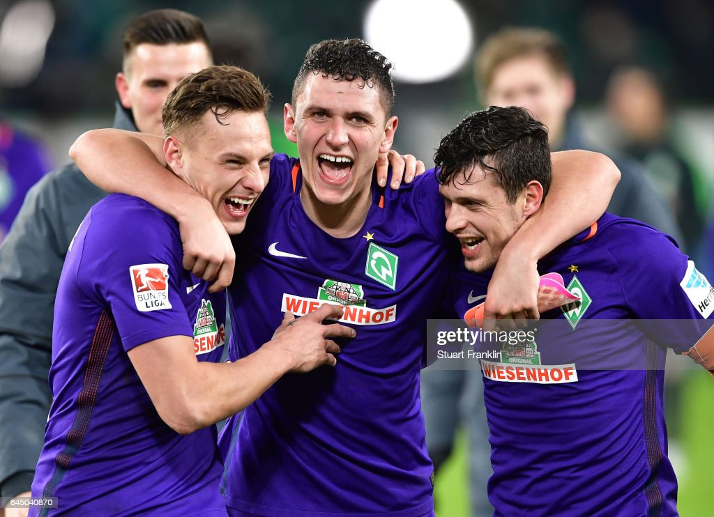 Robert Bauer, Niklas Moisander and Zlatko Junuzovic of Bremen celebrate at the end of the Bundesliga match between VfL Wolfsburg and Werder Bremen at Volkswagen Arena on February 24, 2017 in Wolfsburg, Germany.