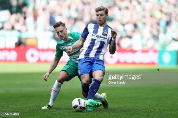 Robert Bauer of Bremen and Alexander Esswein of Berlin compete for the ball during the Bundesliga match between Werder Bremen and Hertha BSC at...
