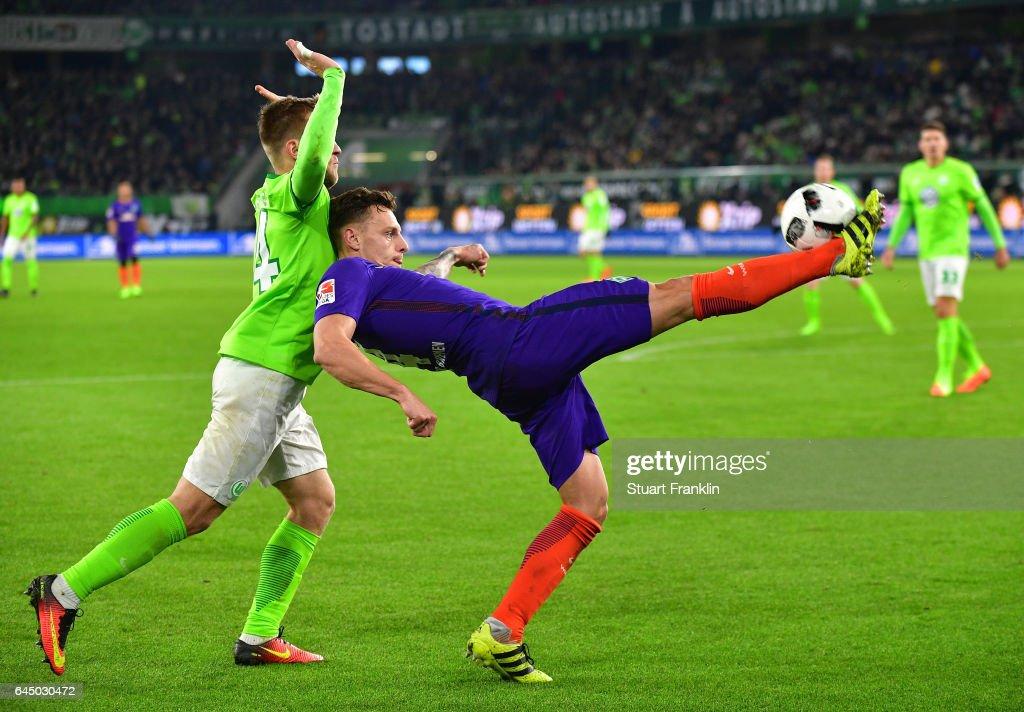 Robert Bauer of Bremen is challenged by Jakub Blaszczykowski of Wolfsburg during the Bundesliga match between VfL Wolfsburg and Werder Bremen at Volkswagen Arena on February 24, 2017 in Wolfsburg, Germany.