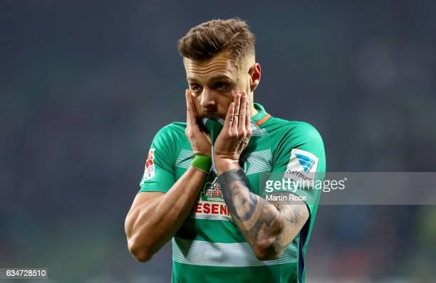 Robert Bauer of Bremen looks dejected after the Bundesliga match between Werder Bremen and Borussia Moenchengladbach at Weserstadion on February 11...
