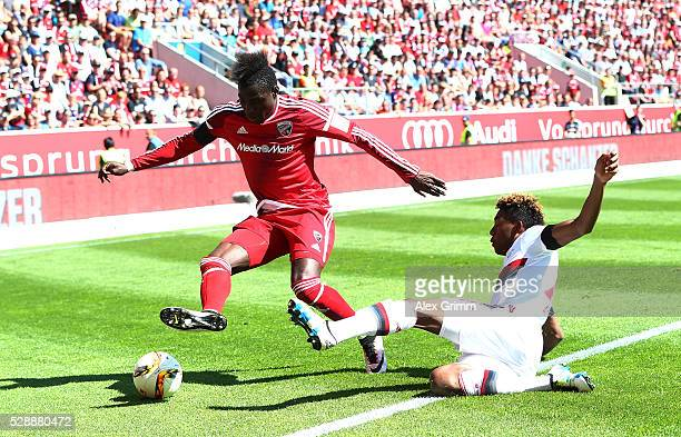 Robert Bauer of FC Ingolstadt is tackled by David Alaba of Bayern Muenchen during the Bundesliga match between FC Ingolstadt and FC Bayern Muenchen...