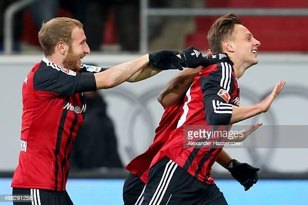 Robert Bauer of Ingolstadt celebrates scoring the first team goal with his team mate Moritz Hartmann during the Bundesliga match between FC...