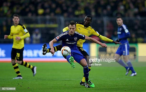 Robert Bauer of Ingolstadt is challenged by Adrian Ramos of Dortmund during the Bundesliga match between Borussia Dortmund and FC Ingolstadt at...
