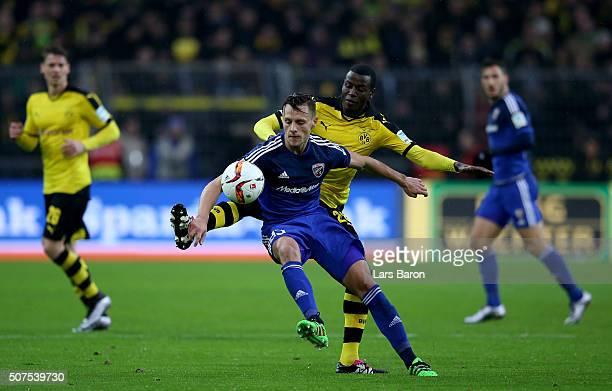 Robert Bauer of Ingolstadt is challenged by Adrian Ramos of Dortmund during the Bundesliga match between Borussia Dortmund and FC Ingolstadt at...