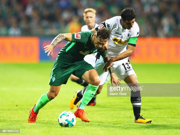 Robert Bauer of Werder Bremen is challenged by Lars Stindl of Borussia Moenchengladbach during the Bundesliga match between SV Werder Bremen and...