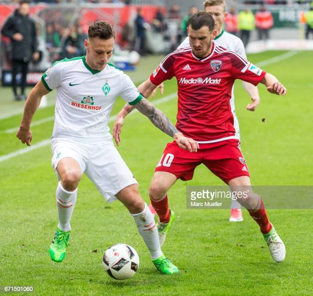 Robert Bauer of Werder Bremen is challenged by Pascal Gross of Ingolstadt during the Bundesliga match between FC Ingolstadt 04 and Werder Bremen at...