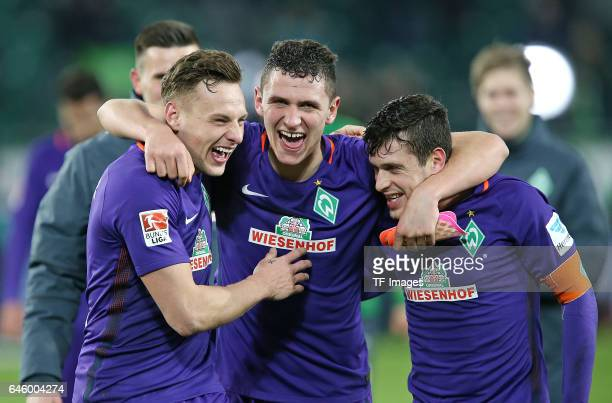 Robert Bauer of Werder Bremen Milos Veljkovic of Werder Bremen and Zlatko Junuzovic of Werder Bremen celebrate their win after the Bundesliga match...