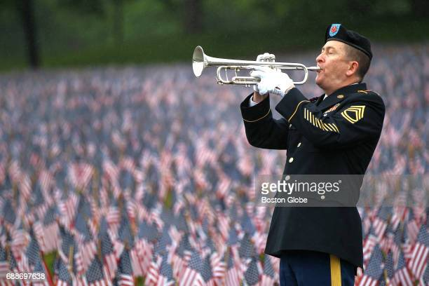 Robert Bean of the Commonwealth Brass Quintet 215th Army Band plays Taps near the end of a Remembering Honoring Our Massachusetts Heroes ceremony on...