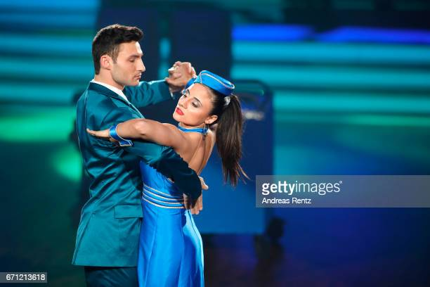 Robert Beitsch and Susi Kentikian perform on stage during the 5th show of the tenth season of the television competition 'Let's Dance' on April 21...