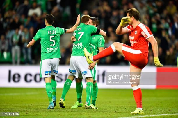 Robert Beric of Saint Etienne celebrates with Kevin Malcuit and Romain Hamouma after scoring during the Ligue 1 match between As Saint Etienne and...