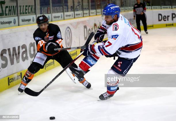 Robert Bina of Wolfsburg and Marcus Kink of Mannheim battle for the puck during the DEL match between Grizzlys Wolfsburg and Adler Mannheim at...