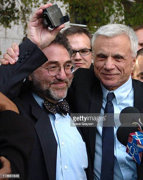 Robert Blake hugs his attorney M Gerald Schwartzbach as he holds the electronic monitoring device Blake was required to wear during trial of his wife...