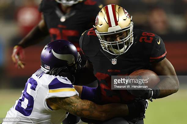 Robert Blanton of the Minnesota Vikings tackles Carlos Hyde of the San Francisco 49ers during their NFL game at Levi's Stadium on September 14 2015...