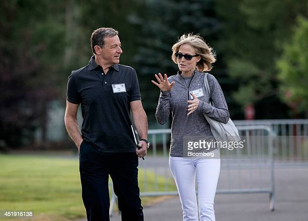 Robert 'Bob' Iger chief executive officer of The Walt Disney Co left and his wife Willow Bay arrive to a morning session at the Sun Valley Lodge...