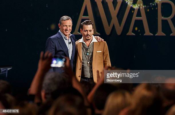 Robert 'Bob' Iger chief executive officer of The Walt Disney Co left stands for a photograph with actor Johnny Depp as he honored during the Disney...