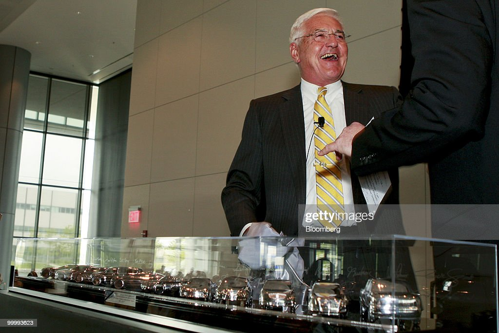 Robert 'Bob' Lutz, former vice chairman of General Motors Co., laughs as he is presented with a case containing models of GM cars that were designed under his tenure during a retirement party for Lutz at the GM Vehicle Engineering Center in Warren, Michigan, U.S., on Tuesday, May 18, 2010. Lutz spent the last 9 years at GM and was responsible for 11 new models, including the Chevrolet Camaro sports car and the upcoming Chevrolet Volt plug-in hybrid. Photographer: Jeff Kowalsky/Bloomberg via Getty Images