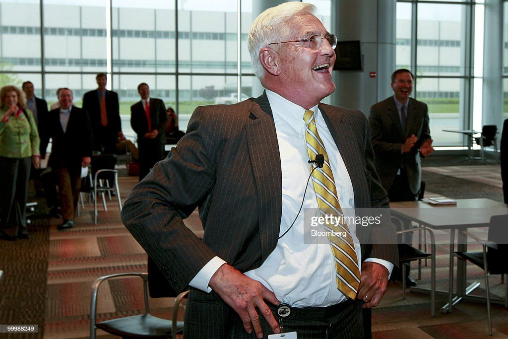 Robert 'Bob' Lutz, former vice chairman of General Motors Co. (GM), smiles as he watches a video during a retirement party for Lutz at the GM Vehicle Engineering Center in Warren, Michigan, U.S., on Tuesday, May 18, 2010. Lutz spent the last 9 years at GM and was responsible for 11 new models, including the Chevrolet Camaro sports car and the upcoming Chevrolet Volt plug-in hybrid. Photographer: Jeff Kowalsky/Bloomberg via Getty Images