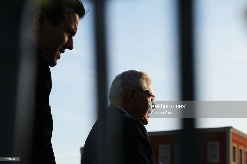 Robert 'Bob' Menendez (D-NJ) walks out of his car with his son Robert Jr., as he arrives at federal court, on November 15, 2017 in Newark, New Jersey. The jury continues to deliberate in his corruption trial.